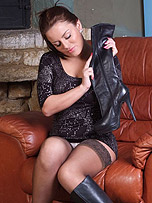 Gorgoeus busty babe Candi is a pure pleasure to look at as she slowly puts on these sexy leather boots and gets out her lovely big boobs