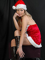 Well look at Santa's special helper Ivana who has a new pair of sexy boots for Christmas to compliment her amazing long legs