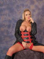 Preview Leatherfixation - Busty blonde stunner Lucy Zara loves to wear leather and slutty red fishnet stockings