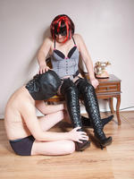 This curvy mistress in leather has a gimp to worship her and then trample over