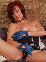 Horny Honey takes off her leather panties and rubs her clit with her leather gloves