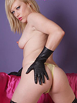 Hot blonde babe in lingerie and leather gloves touches her ass and spreads her tight pussy