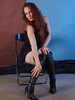 Hot Milf Sammi B strips down to her sexy lingerie wearing a pair of long black leather boots