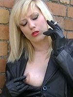 Preview Leatherfixation - Smoking in long leather coat and tight fitting gloves make Axajay one sexy and horny lady, as she flashes her gash in this great fetish movie