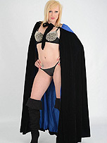 Super girl Axajay is dressed up in a cloak with a tiny thong and gorgeous black boots