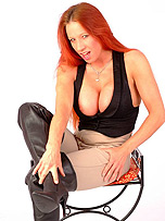 Kinky redhead Faye shows off her great body in these tight jodhpurs and sexy leather boots