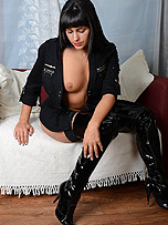Sexy raven haired Simone teases her thigh high shiny black leather boots and plays with her lovely tits