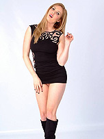 Hottie Louise lifts up her tight black summer dress whilst wearing a pair of sexy leather boots