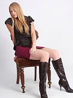 Cute blonde Hayley enjoys putting on a shoe show just for you! Just check out how she slowly teases you as she puts on her thigh high black leather boots