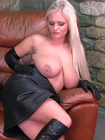 Preview Leatherfixation - Busty blonde babe Charley starts off in boots and gloves and then dresses into a leather skirt! And the tight leather blouse has trouble containing her wonderful huge breasts