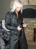 Kinky Milf has a nice surprise for you under her long black leather trench coat
