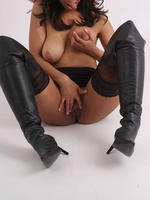 Dark haired beauty Danni strips down to just her boots and then plays with her gorgeous pussy