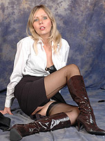 Hot blonde office babe Ivana shows off her sexy legs and shiny black leather boots after work hours